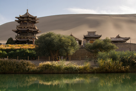 moon  desert: Chinese pavilion near Crescent Moon Lake in desert, Dunhuang, China Stock Photo