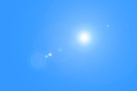 Lens flare in blue sky
