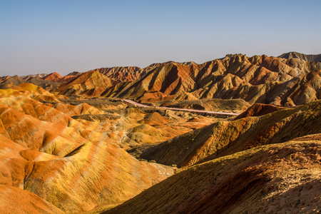 largely: Zhangye Danxia National Geological Park , Gansu Province, China Danxia landform is formed from red-coloured sandstones and conglomerates of largely Cretaceous age.