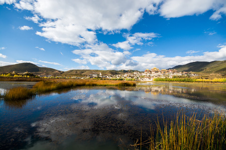 lost lake: The lake and temple in blue sky background, Shangri-la County, Yunnan Province, China Stock Photo
