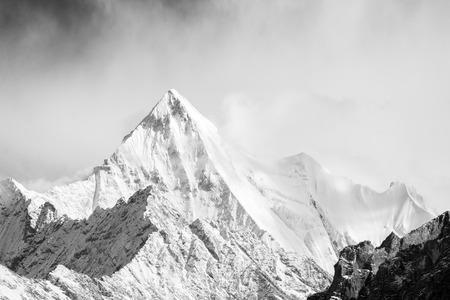 monotone: Mountain peak in monotone with snow cover Stock Photo