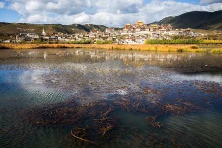 lost lake: Songzanlin Monastery and the lake view foreground, Shangri-la County, Yunnan Province, China Stock Photo
