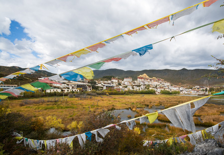 shangrila: Songzanlin Monastery and the tibetan prayer flags foreground, Shangri-la County, Yunnan Province, China