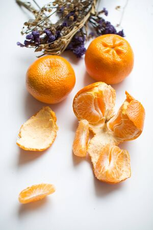 peels: Oranges and peels on white background Stock Photo