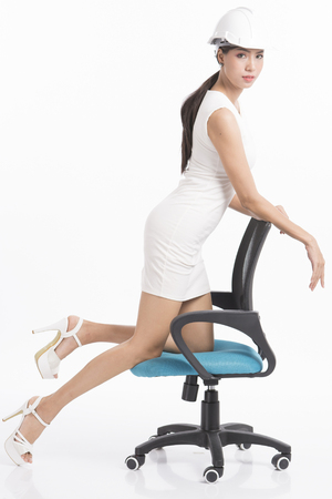 Sexy girl structural engineer working on white background