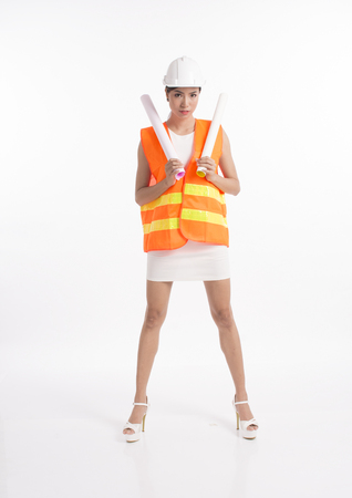 Sexy girl structural engineer holding drafting paper, white background photo