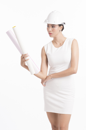 Sexy girl structural engineer holding drafting paper with copy space for product or text, white background photo Stock Photo
