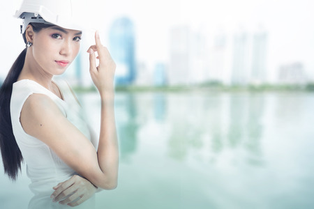 Female engineer with blur buildings background Stock Photo