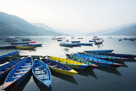 phewa: Boats at Phewa Lake in the evening, Pokhara, Nepal
