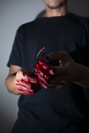 Psychotic murderer and a knife in his bloody hands