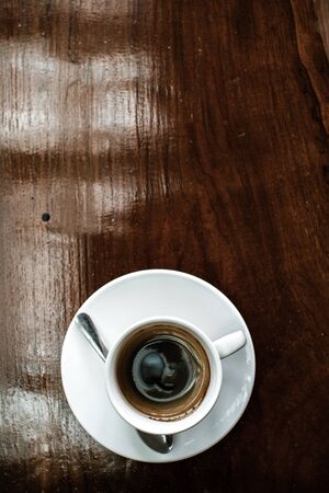Cup of coffee on brown wooden table Reklamní fotografie