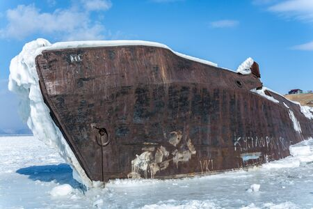 Ship in ice lake against blue sky in winter Reklamní fotografie