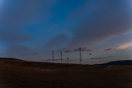 Landscape photography of hill at twilight, telecommunication pole on hill