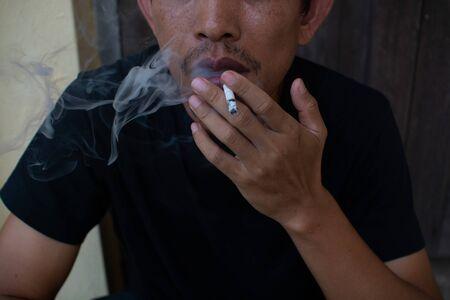 Man smoking cigarette, close-up photography Reklamní fotografie