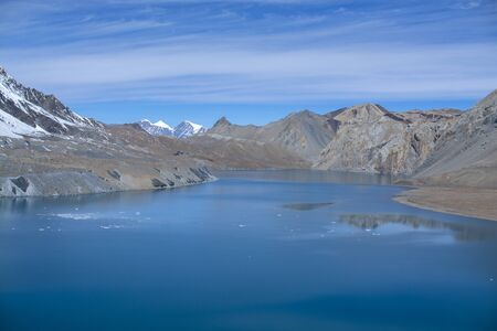 Tilicho Lake in Annapurna Conservation Area, Nepal, blue lake on mountain against sky Stock fotó