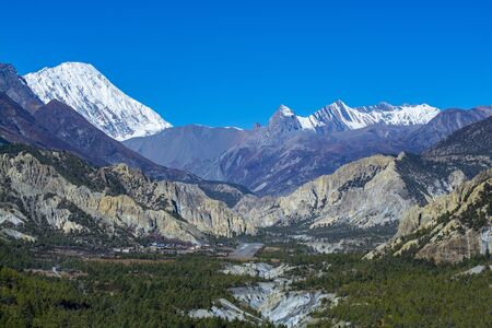 Landscape view of pine forest and mountains at background, Annapurna Conservation Area, Nepal Stock fotó
