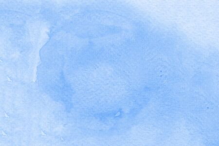 Watercolor texture on paper in blue color for background