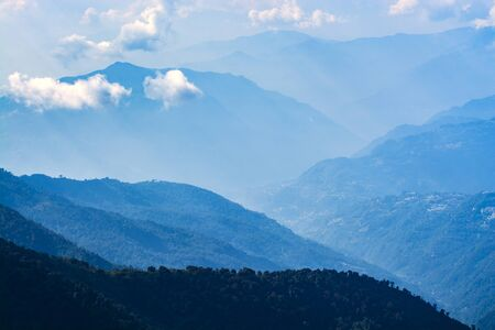 Mountains in blue tone with clouds, travel in India, Himalayas Range, landscape image Stock Photo