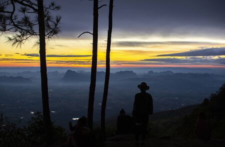 People looking at view in the morning, Phu Kradueng National Park, Thailand