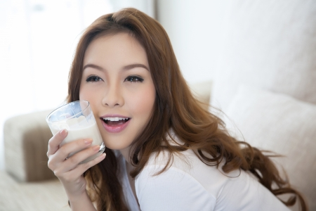 happy and smiling Woman drinking milk  版權商用圖片