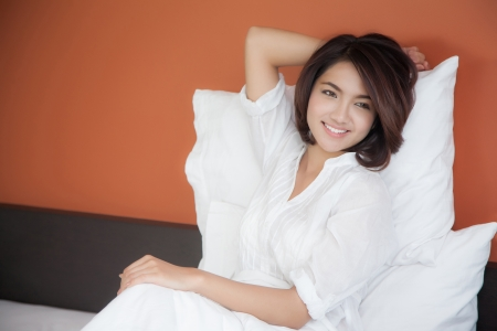 good night: Young beautiful woman waking up happily, after a good night sleep Stock Photo
