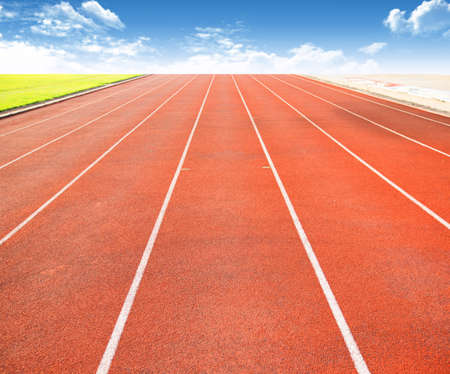 Running track with lanes over sky and clouds  photo