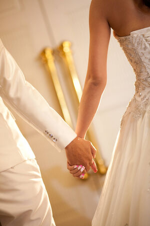 Bride and groom holding hand waiting for wedding ceremony photo