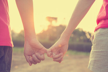 romance image: Filtered image, couple holding hands in wedding outdoor theme