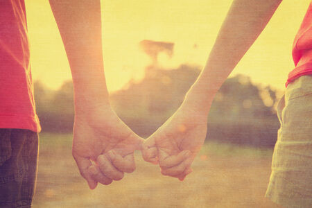 a newly married couple: Filtered image, couple holding hands in wedding outdoor theme