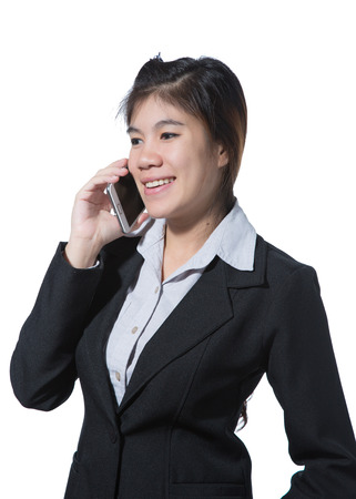 Young beautiful smileing business woman talking with mobile phone in her hand photo