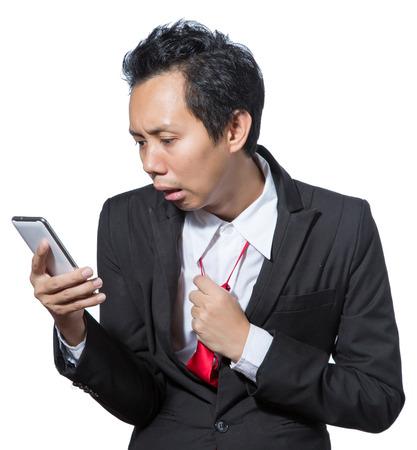 stockholder: Stressed businessman looking tablet and pulling necktie