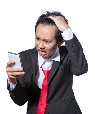 stockholder: Stressed businessman looking tablet , concept strain with result