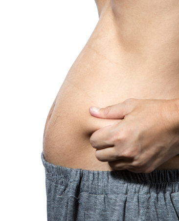 pinches: Man with overweight  pinches the excess fat  around the waist Stock Photo