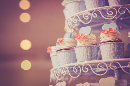 Cup cake for wedding ceremony. Cross processed image for vintage look 版權商用圖片