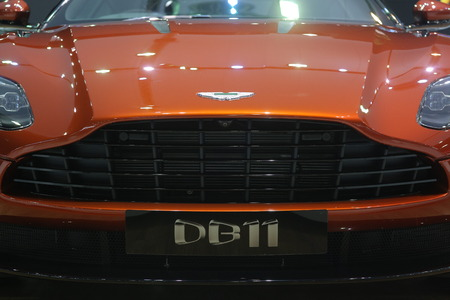 spectre: Bangkok - March 31 : Aston martin Spectre 007 DB11 on Orange car at The 37th Bangkok International Thailand Motor Show 2016 on March 31, 2016 in Bangkok, Thailand