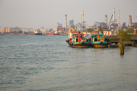convoy: Fishing boat at port with convoy industry and city on backgrpund