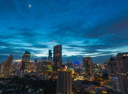 Aerial view of cityscape skyline concept, Background of Bangkok city with sunset skyscrapers