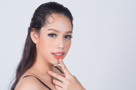 sexy asian woman: Beautiful Asian young woman with clean fresh skin for skincare or healthy concept on white background with copy space for product and design