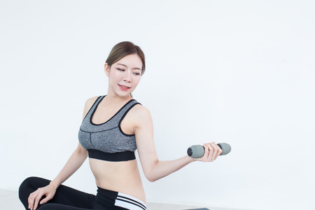 sexy asian woman: Young Fitness Asian girl lifting dumbbell, workout in bedroom, fitness, training and lifestyle concept