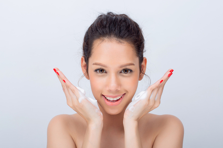 Close up of beautiful young woman with cleansing foam for skin care 版權商用圖片