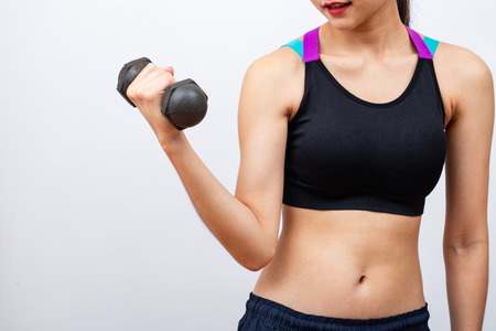 Fitness women lifing and holding dumbbell on white background 版權商用圖片