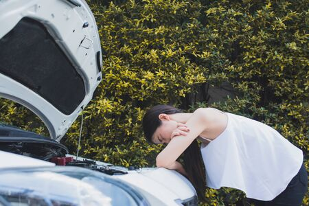 Asian stressed woman near broken car feeling desperate for trouble with vehicle 스톡 콘텐츠