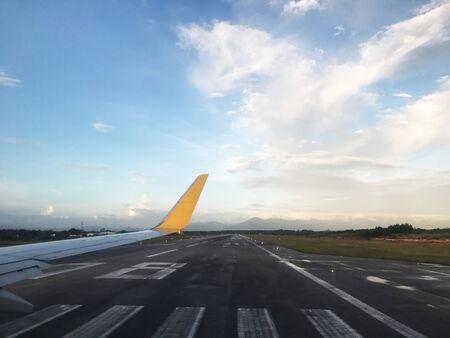 Airplane in landing runway road, blue sky in airport.