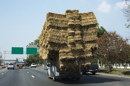 Rice straw, Overloaded truck on road in Saraburi Province, Thailand/ March 2018