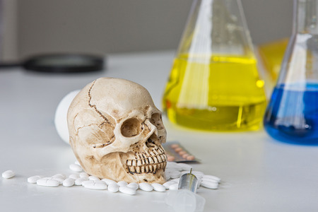 Science laboratory test tubes. Skull and beaker chemical. Volatile substances and skull laboratory. glassware with liquids of different colors.