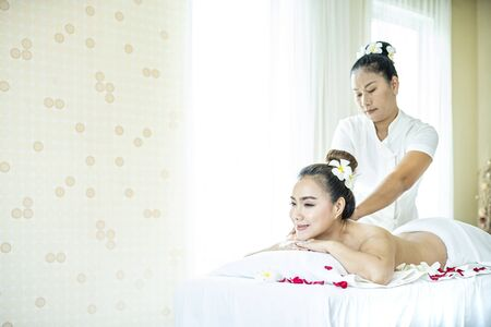 Beautiful woman in spa. Young and healthy female in spa. Asian woman in wellness beauty spa having aroma therapy massage with essential oil. Thailand. Stock Photo
