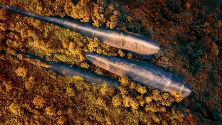 Three whale stones is Popular natural attractions in Thailand. Bird eye view shot of three whales rock in Phu Sing Country park in Bungkarn, Thailand. In the autumn.