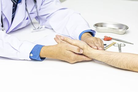 Alternative medicine concept. The doctor is measuring the pulse. Traditional doctor measuring pulse of patient.