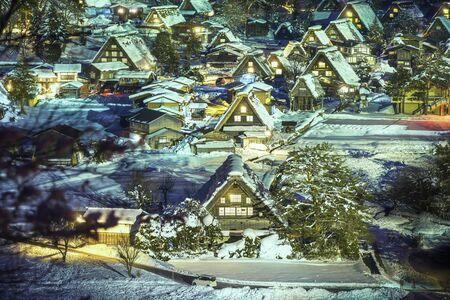 Long exposure photograph with grain. The landscape of Japan. Shirakawago twightlight. Historic Village of Shirakawago in winter. Gifu, Japan