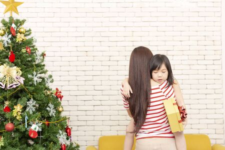 Merry Christmas and Happy Holidays concept. Single Mom. Mothers who have to raise an only child on Christmas Day.